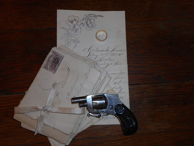 Gold band, gun and letters belonging to Lillie Mae Seales