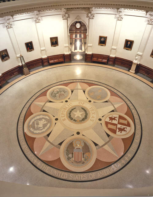 Installed in 1936 to commemorate 100 years of statehood, the floor design includes the seals of the six nations that have governed Texas.