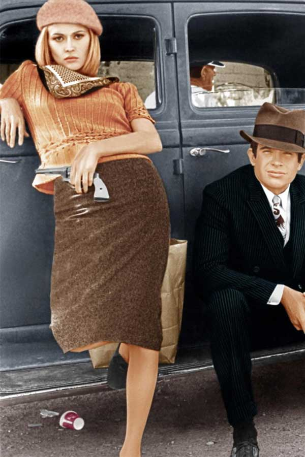 Bonnie and Clyde posing in front of a car, 1967
