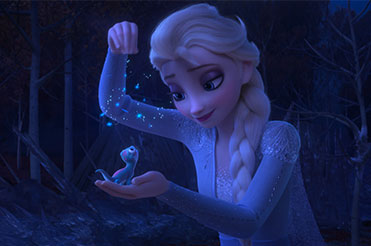 Elsa dropping snowflakes on a small salamander in her hand