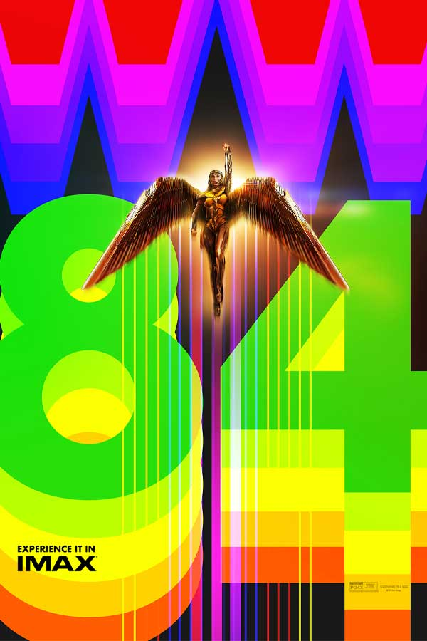 Wonder Woman in a gold outfit with golden wings spread out, her left fist is in the air. The background is rainbow colored spelling out