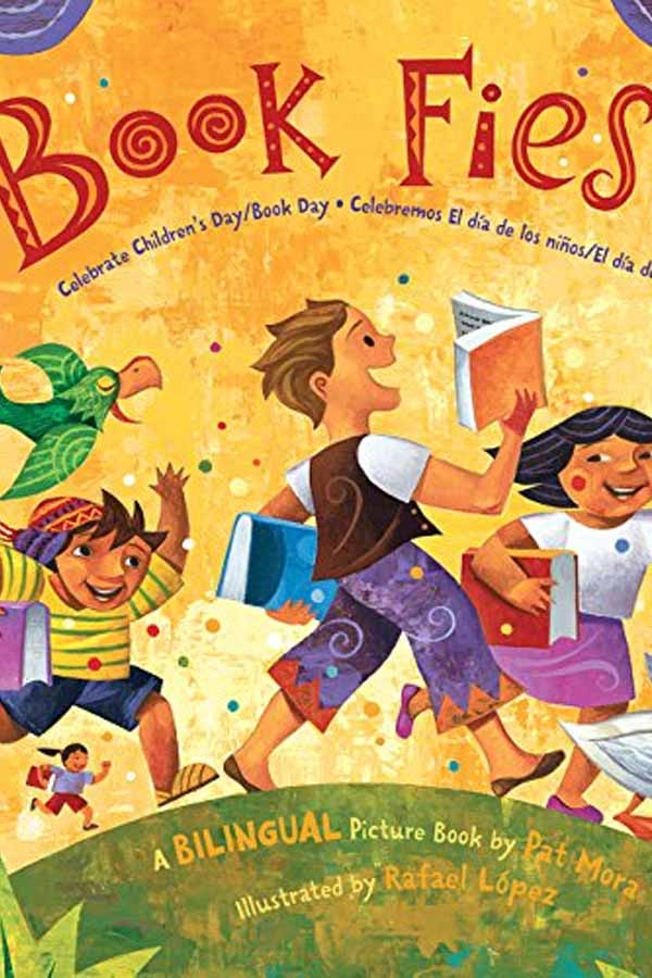 "Cover of children's book, ""Book Fiesta,"" three children running over a hill carrying books"