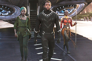 Black Panther still: Black Panther on roof of car