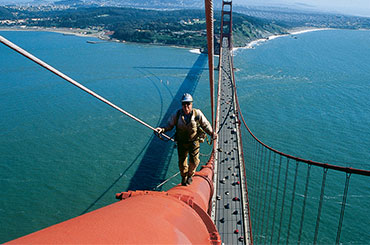 Still from Dream Big: Engineer climbing on bridge