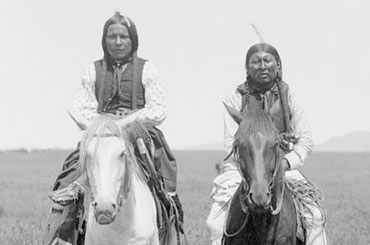 Photograph of Comanche people on horseback