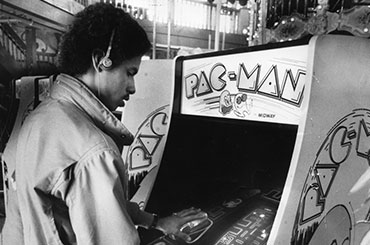 Man playing Pac Man