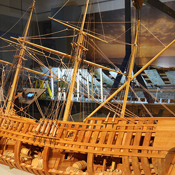 A scale model of the La Belle is on display in front of the ship's preserved and reconstructed hull.