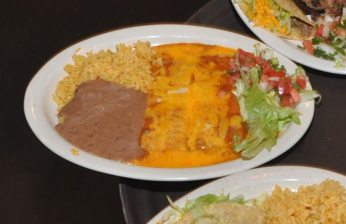 Enchiladas, rice, and beans