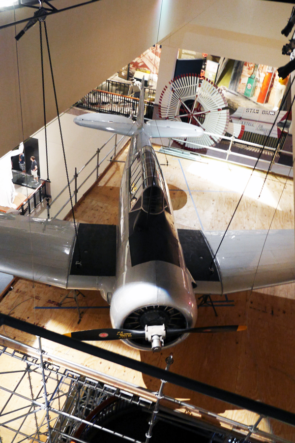 "The Bullock Texas State History Museum's AT-6A WWII ""Texan"" aircraft took flight this week above the Museum's three-storied exhibition atrium."