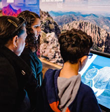 Three people looking at Bison Interactive