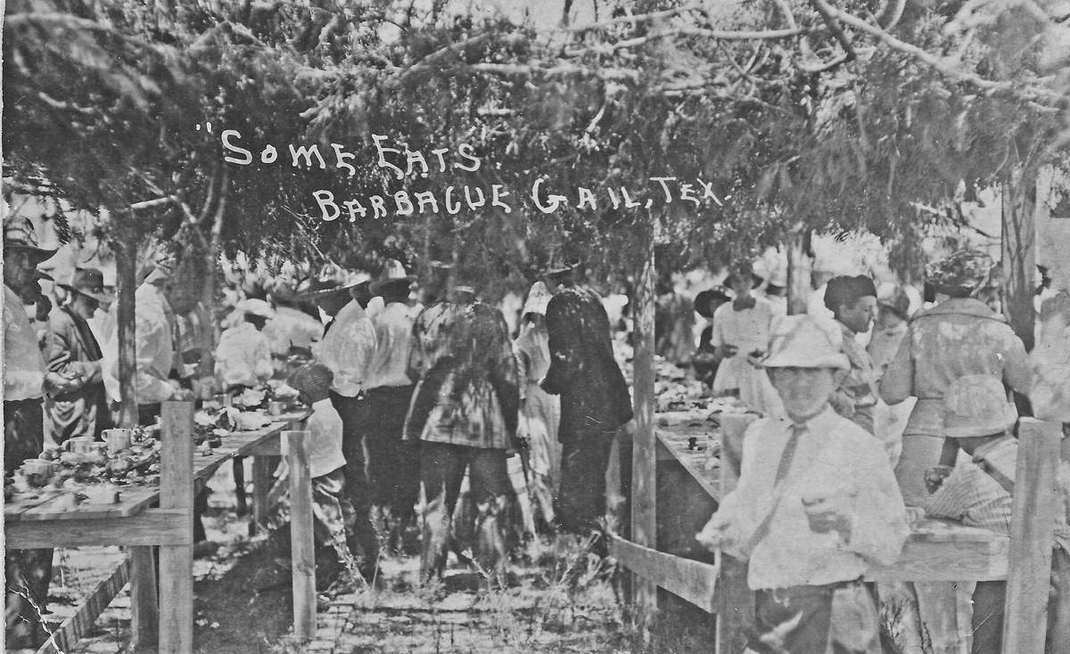Brush arbor covering barbecue at a Gail three day picnic