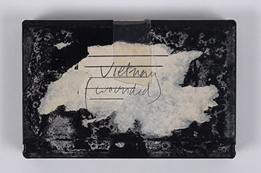 "Photo of an old black recording tape that reads ""Vietnam (wounded)"""