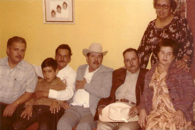 Photograph from left to right: Enrique Ruiz Montalvo, Lorenzo Ruiz Montalvo, Pablo Ruiz Montalvo (wearing hat, Noe's father), Octavio Ruiz Montalvo, lady sitting down Alfa Dalia Ruiz Montalvo (aunt) and lady standing in back is Hermina Ruiz, aunt, and of course, Noe, sitting next to his father on Lorenzo Ruiz Montalvo's lap.